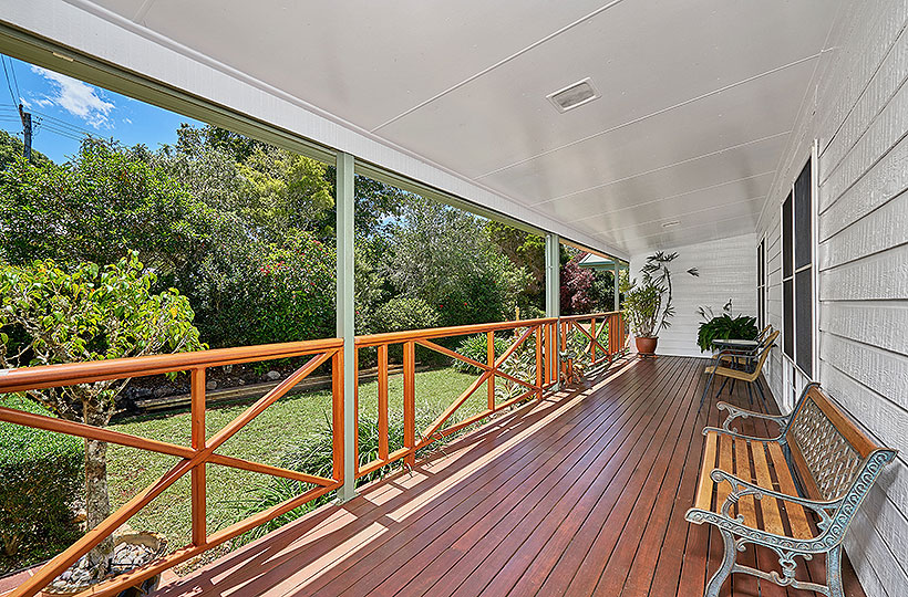 Wide, shaded verandahs frame the three-bedroom cottage